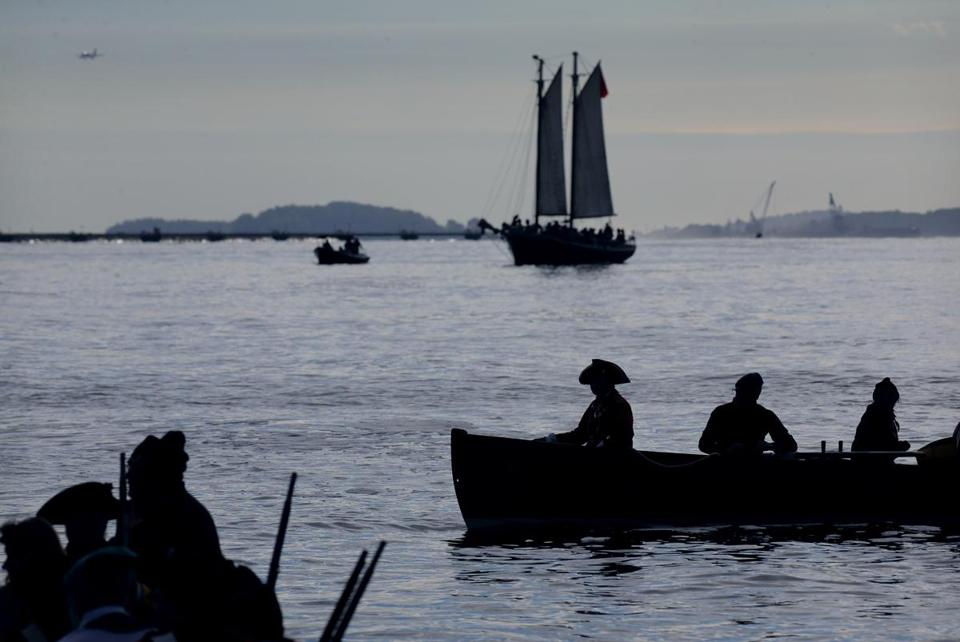 Boston, MA - October 06, 2018: British reenactors arrive at Long Wharf in long boats and a schooner during ÒBoston Occupied: An Insolent ParadeÓ in Boston, MA on October 06, 2018. (Exactly 250 years after British soldiers landed in Boston Harbor for the first time, Bostonians this weekend will once again be able to yell, ÒThe Redcoats are coming!Ó A troupe of about 150 Redcoat reenactors will land at Long Wharf Saturday morning and march into downtown Boston to commemorate the sestercentennial anniversary of when the red-clad British nationals first arrived in the city in October of 1768. The reproduction of the soldiersÕ arrival and the march that will follow it comprise ÒBoston Occupied: An Insolent ParadeÓ Ñ the signature event organized by Revolution 250, a group of organizations, including the Massachusetts Historical Society, working together to commemorate the 250th anniversary of the events that eventually culminated in the coloniesÕ independence from Britain.) (Craig F. Walker/Globe Staff) section: Metro reporter: