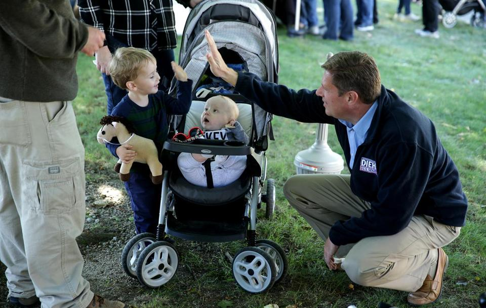 Geoff Diehl greeted Gordon Bennette and his little brother, Wilson, at the Cranberry Harvest Celebration in Wareham on Saturday.
