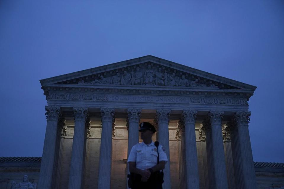 WASHINGTON, DC - OCTOBER 05: A police officer stands guard in front of the U.S. Supreme Court October 5, 2018 in Washington, DC. The Senate voted 51-49 in a procedural vote to advance the nomination of Judge Brett Kavanaugh to the U.S. Supreme Court. (Photo by Alex Wong/Getty Images)