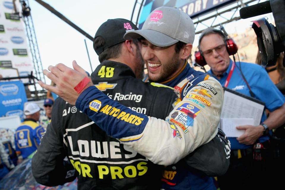 DOVER, DE - OCTOBER 07: Chase Elliott, driver of the #9 NAPA Auto Parts Chevrolet, is congratulated by Jimmie Johnson, driver of the #48 Lowe's for Pros Chevrolet, in Victory Lane after winning the Monster Energy NASCAR Cup Series Gander Outdoors 400 at Dover International Speedway on October 7, 2018 in Dover, Delaware. (Photo by Brian Lawdermilk/Getty Images)