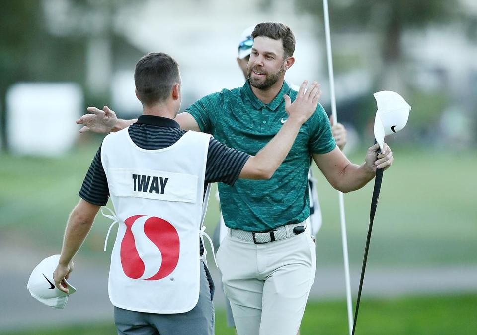 NAPA, CA - OCTOBER 07: Kevin Tway reacts with his caddie Marc Sambol after putting in to win on a third hole sudden death playoff against Ryan Moore on the 10th green during the final round of the Safeway Open at the North Course of the Silverado Resort and Spa on October 7, 2018 in Napa, California. (Photo by Marianna Massey/Getty Images)