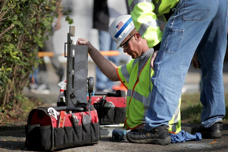 Replacement crews worked on a natural gas line on Wyman Street in Woburn on Tuesday.