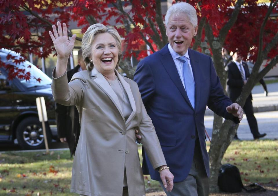"FILE - In this Nov. 8, 2016, file photo, Democratic presidential candidate Hillary Clinton, and her husband former President Bill Clinton, greet supporters after voting in Chappaqua, N.Y. The Clintons announced Monday, Oct. 8, 2018, they will visit four cities in 2018 and nine in 2019 across North America in a series of conversations dubbed ""An Evening with President Bill Clinton and former Secretary of State Hillary Rodham Clinton."" (AP Photo/Seth Wenig, File)"