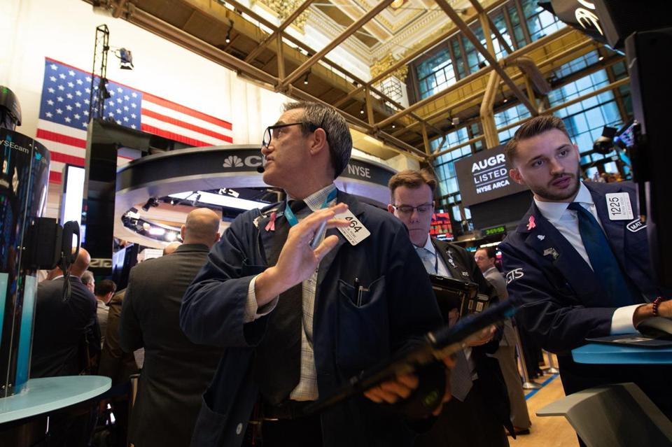Traders worked on the floor near the close of trading on the New York Stock Exchange Wednesday in New York. Wall Street stocks dropped Wednesday, with major indexes losing more than 3 percent.