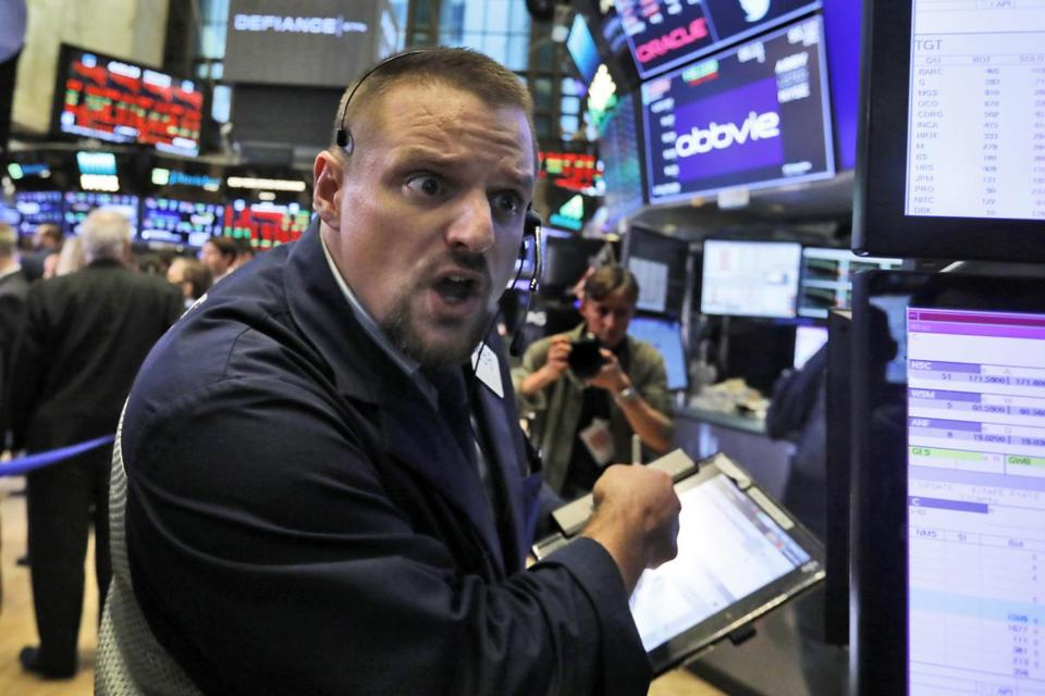 Trader Michael Milano worked on the floor of the New York Stock Exchange on a wild Wednesday.