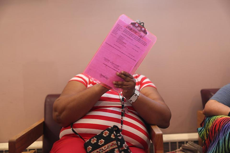 Erica Harris registered to vote for the first time ever at the Pine Street Inn's voter registration forum on Wednesday.