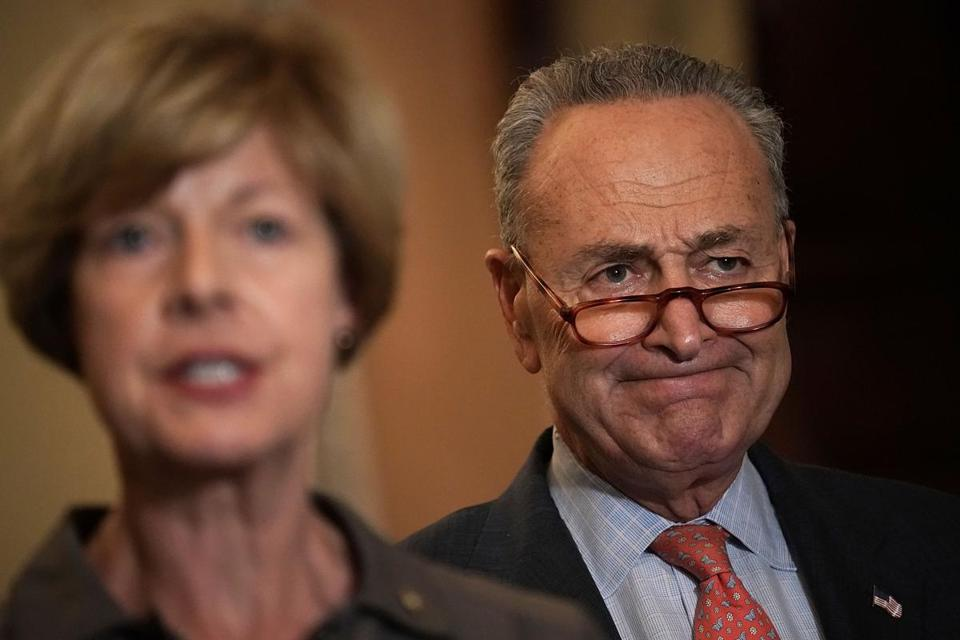 Senator Tammy Baldwin (front) and Senator Chuck Schumer at a press conference Wednesday at the US Capitol.