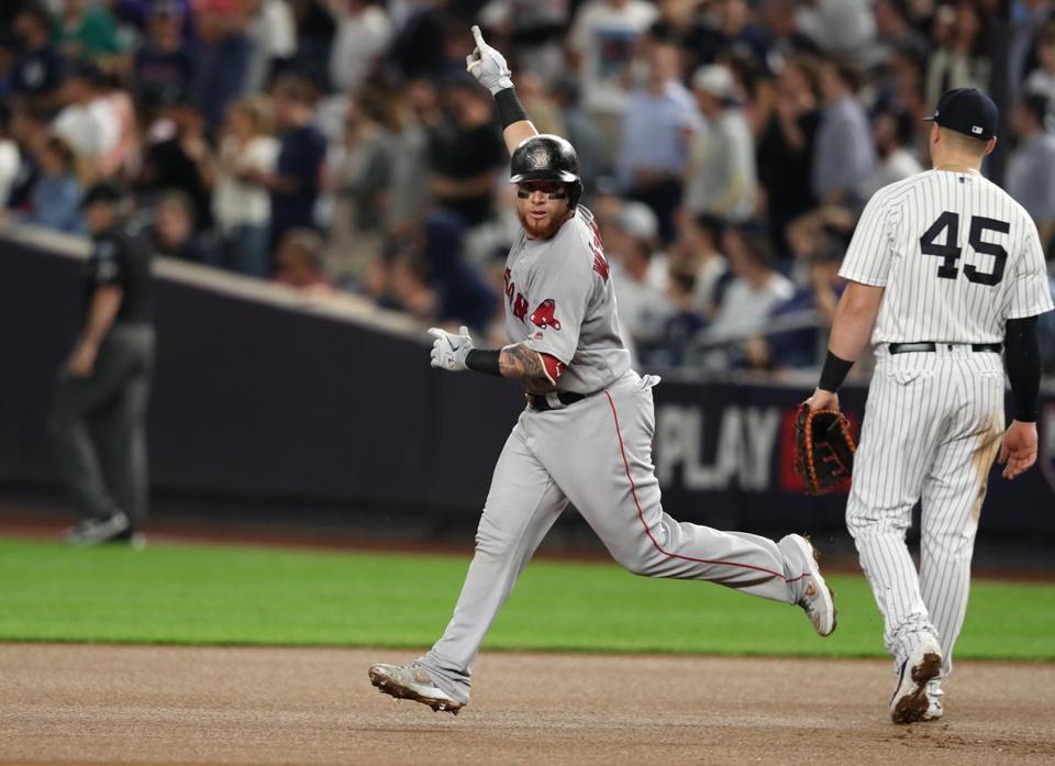 New York, NY- 10/9/18 - Yankee Stadium - Christian Vazquez passes Yankee 1st baseman Luke Voit after hitting home run in 4th inning. Boston Red Sox vs. New York Yankees in game 4 of the ALDS at Yankee Stadium. (Jim Davis/Globe staff)