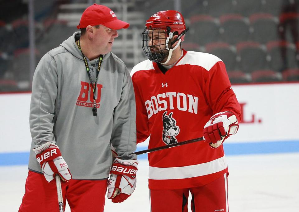 The new head coach with forward Gabriel Chabot during practice at Agganis Arena.