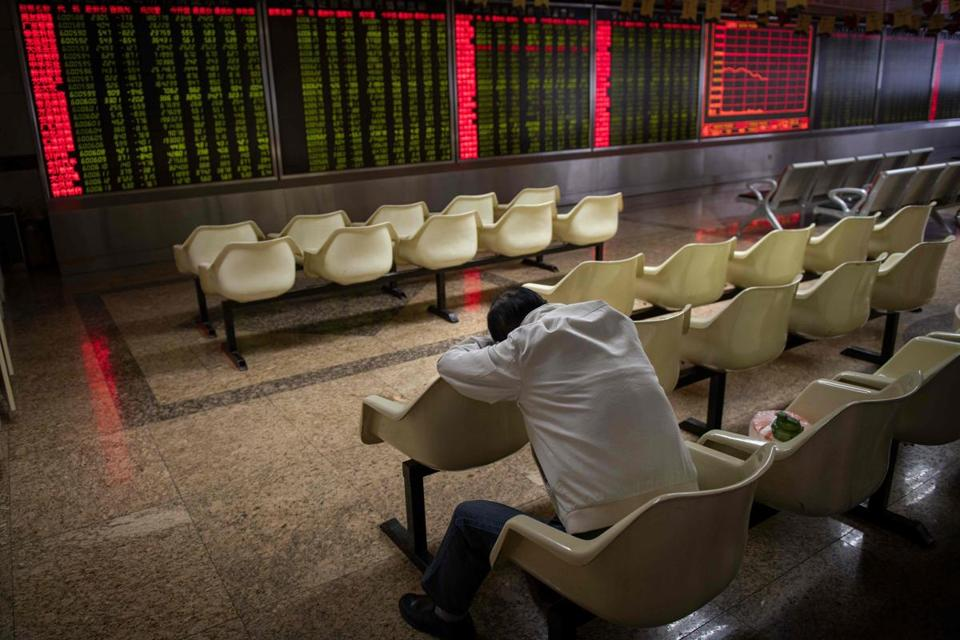Stock prices were displayed Thursday at a securities firm in Beijing. Trade tensions with China are weighing on stocks.