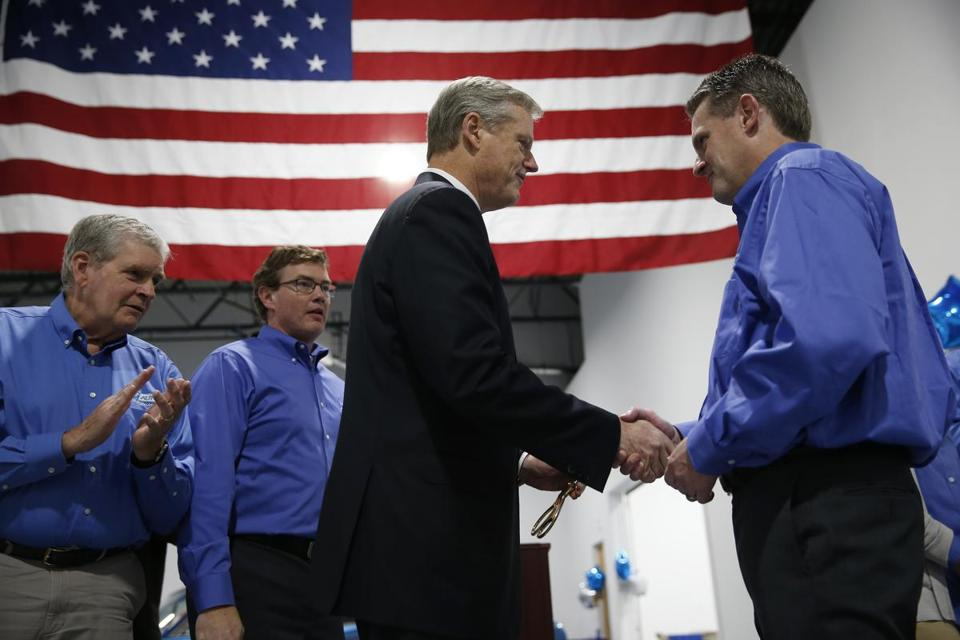 Baker shook hands with Republican congressional candidate Rick Green in Pepperell on Thursday.
