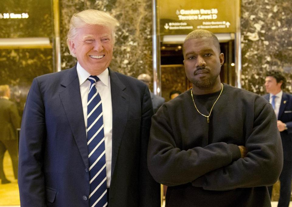 In this Dec. 13, 2016, file photo, then President-elect Donald Trump and Kanye West pose for a picture in the lobby of Trump Tower in New York.