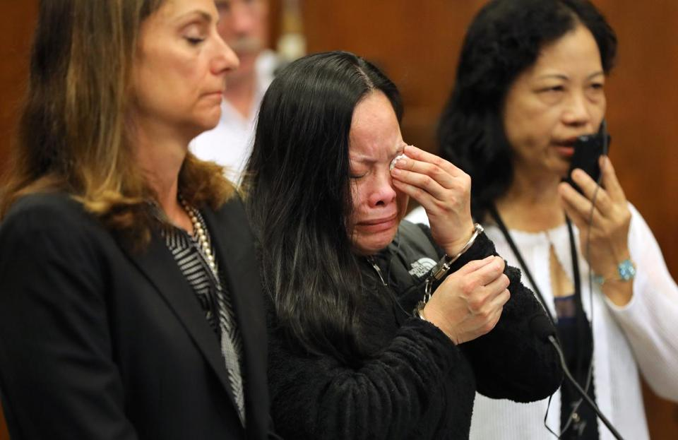 Xiao Ying Zhou (center) wept at her sentencing. Her lawyer, Michelle Troiano, is beside her.