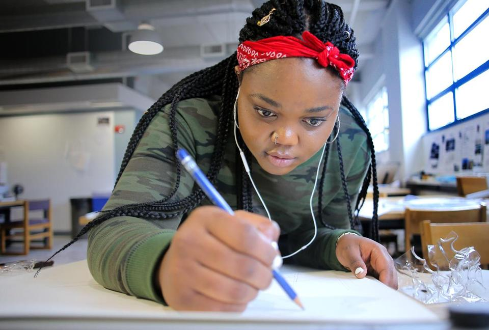 Esther Bahati worked on a drawing at Wentworth's architecture lab.