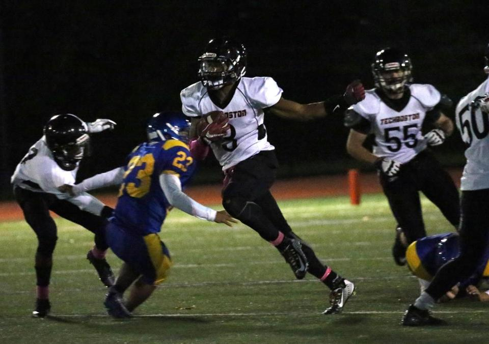 (East Boston, MA 10/12/18) TechBoston's #3 Marcu Gonzalez runs the ball in the second quarter of their game against East Boston in East Boston. (Photo by John Wilcox for the Globe)