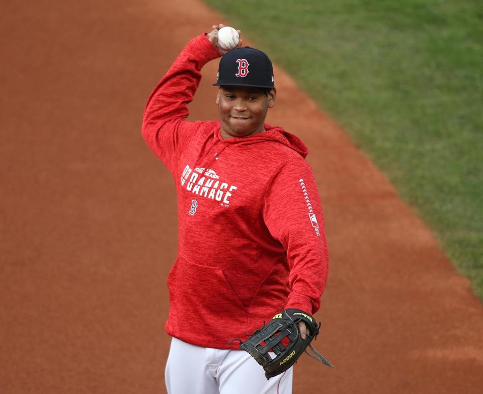 Boston, MA 10/14/18: Red Sox Rafael Devers warms up before the game , Boston Red Sox hosted the Houston Astros on Sunday, October 14, 2018 in the second game of the ALCS at Fenway Park. (Stan Grossfeld / Globe staff)