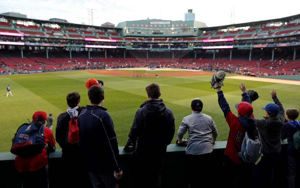 BOSTON, MA 10-14-18: Fans wait for a fly ball to centerfield during the Beat practice before the game. Boston Red Sox hosted the Houston Astros in Game Two of ALCS at Fenway Park Sunday, October 14, 2018. (John Tlumacki / Globe Staff)