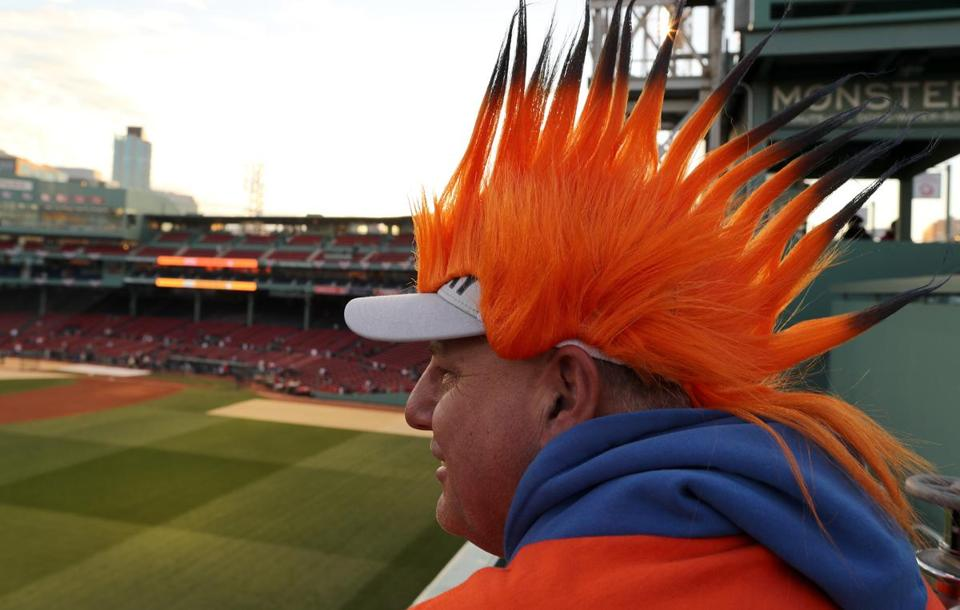 Boston, MA 10/14/18: Brian Hamm, an Astros fan, at the green monster in Fenway Park before game two of the ALCS. Boston Red Sox hosted the Houston Astros in Game Two of ALCS at Fenway Park Sunday, October 14, 2018. (John Tlumacki / Globe Staff)