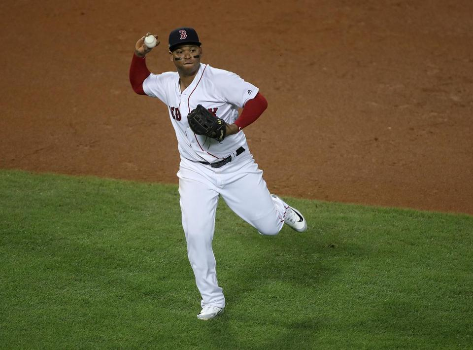 Boston, MA 10/14/18: Red Sox Rafael Devers throws first for an out in the fifth inning. Boston Red Sox hosted the Houston Astros in the second game of the ALC at Fenway Park Sunday, October 14, 2018. (Stan Grossfeld / Globe Bar)