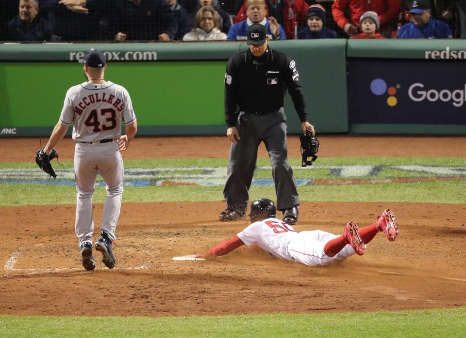 Boston, MA 10/14/18: Red Sox Mookie Betts strikes a past ball in the seventh inning. Boston Red Sox hosted the Houston Astros in Game Two of ALCS at Fenway Park Sunday, October 14, 2018. (John Tlumacki / Globe Staff)