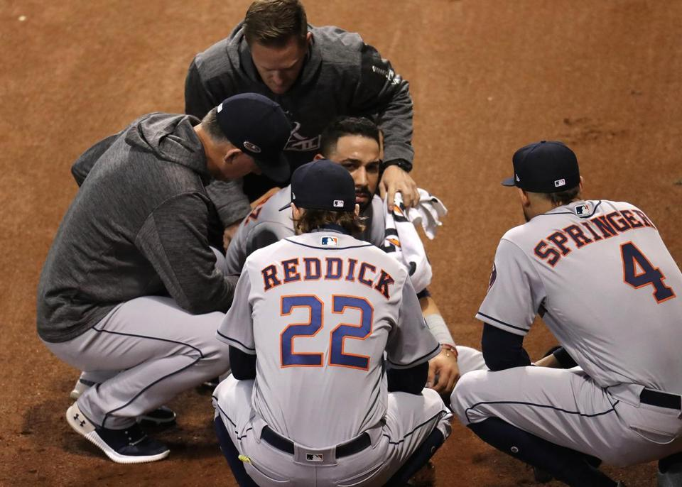 Boston, MA 10/14/18: Astros Marwin Gonzalez (center) is checked out in the third inning. Boston Red Sox hosted the Houston Astros in Game Two of the ALCS at Fenway Park Sunday, October 14, 2018. (John Tlumacki / Globe Staff)
