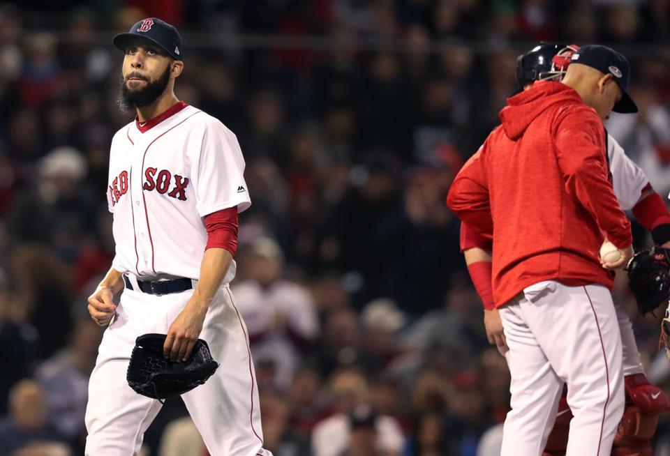 Boston, MA: 10-14-18: Red Sox starter David Price (left) leaves the game after being pulled by manager Alex Cora (right) with two outs at the top of the fifth innings. The Boston Red Sox hosted the Houston Astros in the second game of their ALCS baseball matchup at Fenway Park. (Jim Davis / Globe Staff)