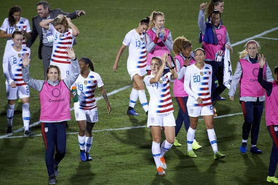 The US women's soccer team applauds their achievements: a 6-0 win over Jamaica and a berth in the World Cup.