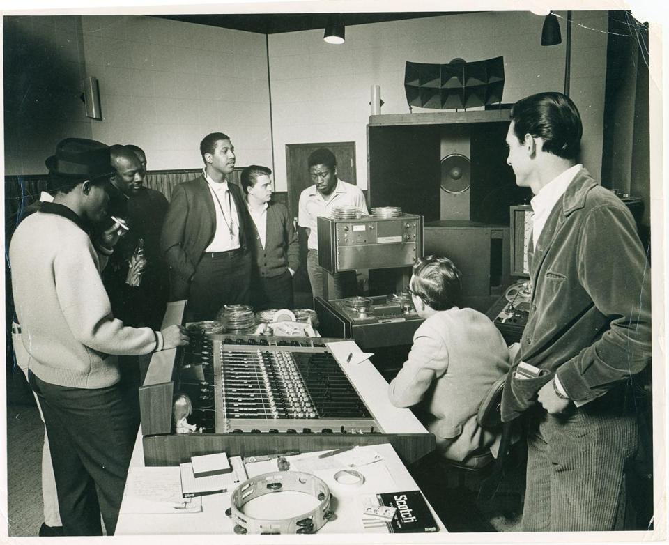 From left: Sam Moore, David Porter (behind Moore), Isaac Hayes, Booker T. Jones (behind Hayes), Andrew Love, Wayne Jackson, Dave Prater, Jim Stewart, and Steve Cropper at Stax Records, circa 1970.