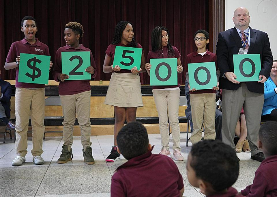 Cambridge, MA., 10/16/2018 Students at the Benjamin Banneker Charter Public School react to the dollar amount about to be awarded to librarian Jennifer Gordon. She received a Milken Educator Award -- a prize that comes with $25,000--during a surprise ceremony at the Benjamin Banneker Charter Public School. Suzanne Kreiter/Globe staff