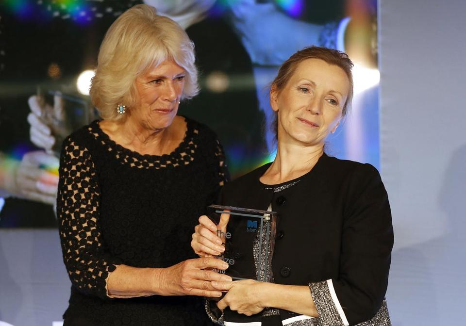 Britain's Camilla, the Duchess of Cornwall presents the Man Booker Prize for Fiction 2018 to British writer Anna Burns during the prize's 50th year at the Guildhall in London, Tuesday, Oct. 16, 2018.(AP Photo/Frank Augstein, Pool)