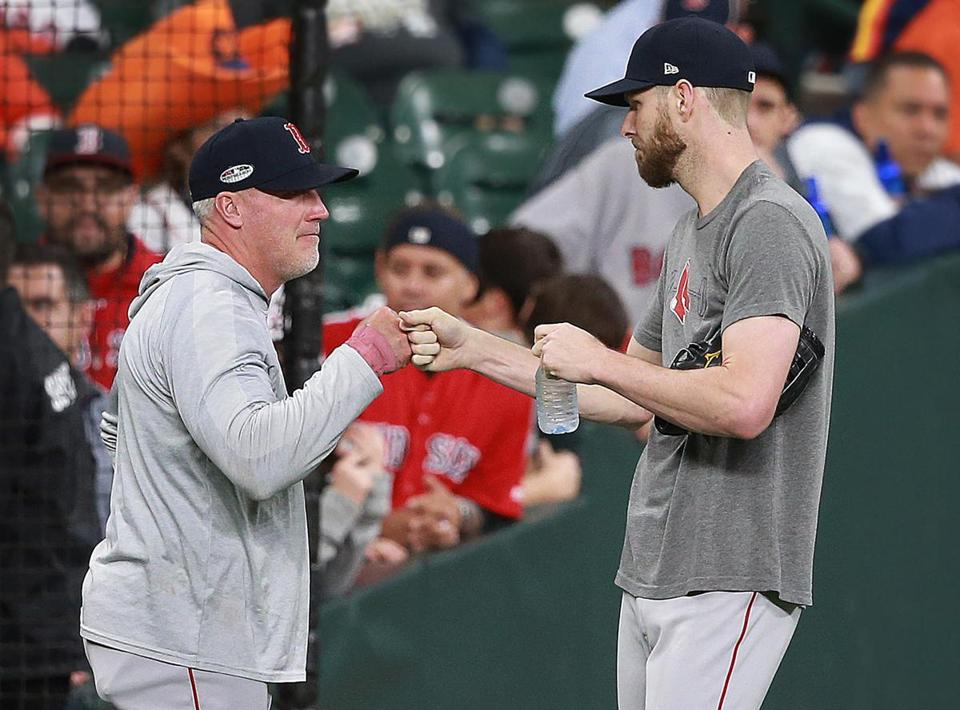 Pitcher Chris Sale (right) and pitching coach Dana LeVangie.