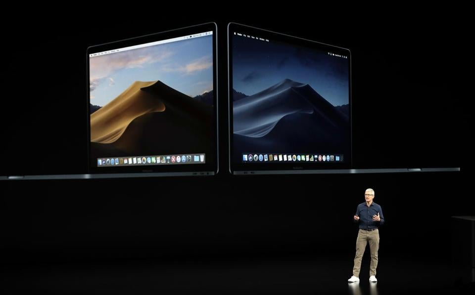 Apple CEO Tim Cook discusses the new MacBook at the Steve Jobs Theater during an event to announce new products Wednesday, Sept. 12, 2018, in Cupertino, Calif. (AP Photo/Marcio Jose Sanchez)