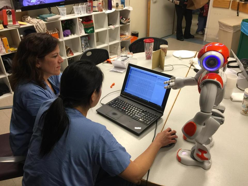 A team from MIT programmed a robot to function as a nurse manager. Team members from Beth Israel Deaconess Medical Center (pictured) participated in an experiment involving the robot on the labor and delivery floor in 2015.