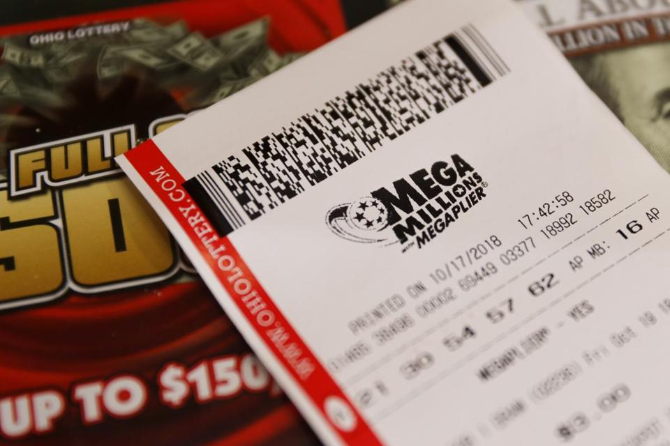 A Mega Millions lottery ticket rested on the shop counter at the Street Corner Market on Wednesday in Cincinnati.