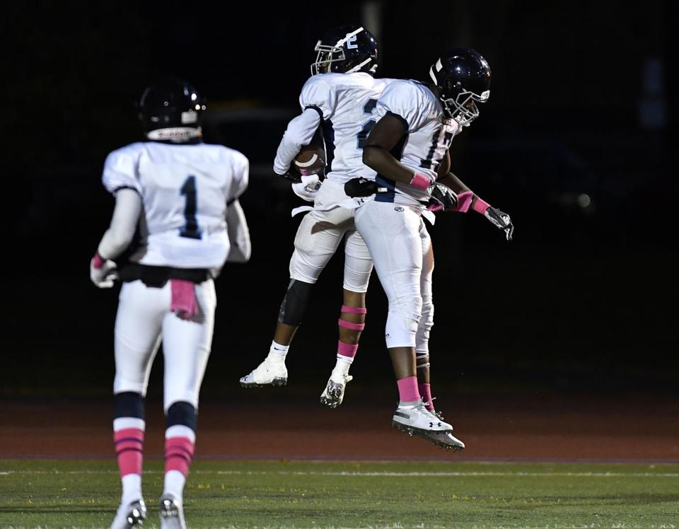 CHARLESTOWN, 10/19/2018 - Takahri Hobbs, (#2) and Hakeem Olaogun, (#17) of Unbeaten Boston English celebrate aftter Hobbs scored a first half touchdown against Charleston in the Boston City League South championship game. Josh Reynolds for The Boston Globe (Sports, weitzer)