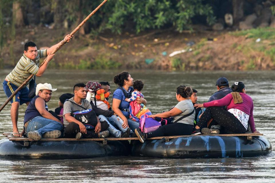 Honduran migrants crossed the Suchiate River between Guatemala and Mexico on Sunday. In dozens of interviews, migrants have said they are fleeing widespread violence, poverty, and corruption in their country.