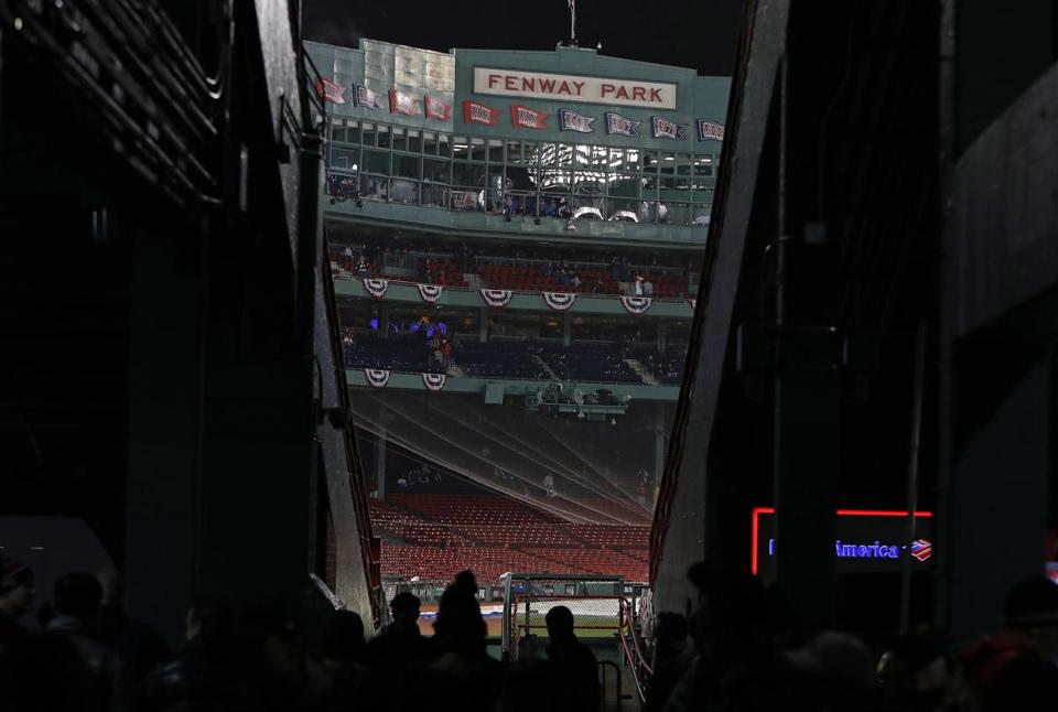 Fans were instructed to take cover as a storm moved through the area.
