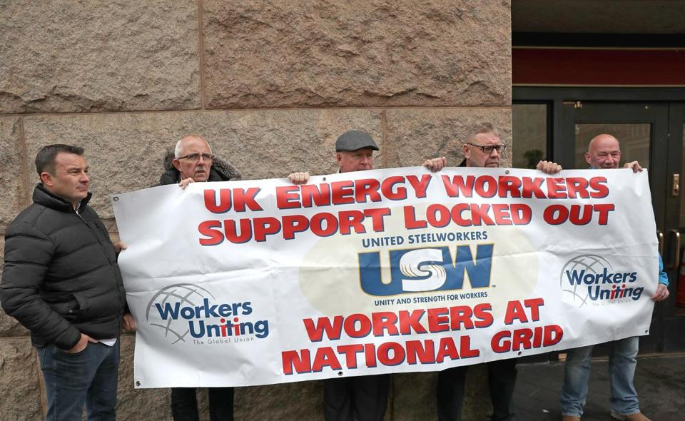 Union members from the UK demonstrated outside of South Station on Wednesday in support of National Grid workers locked out of their jobs since late June in a contract dispute.