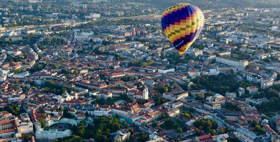 A hot air balloon floats over Lithuania's capital city of Vilnius.