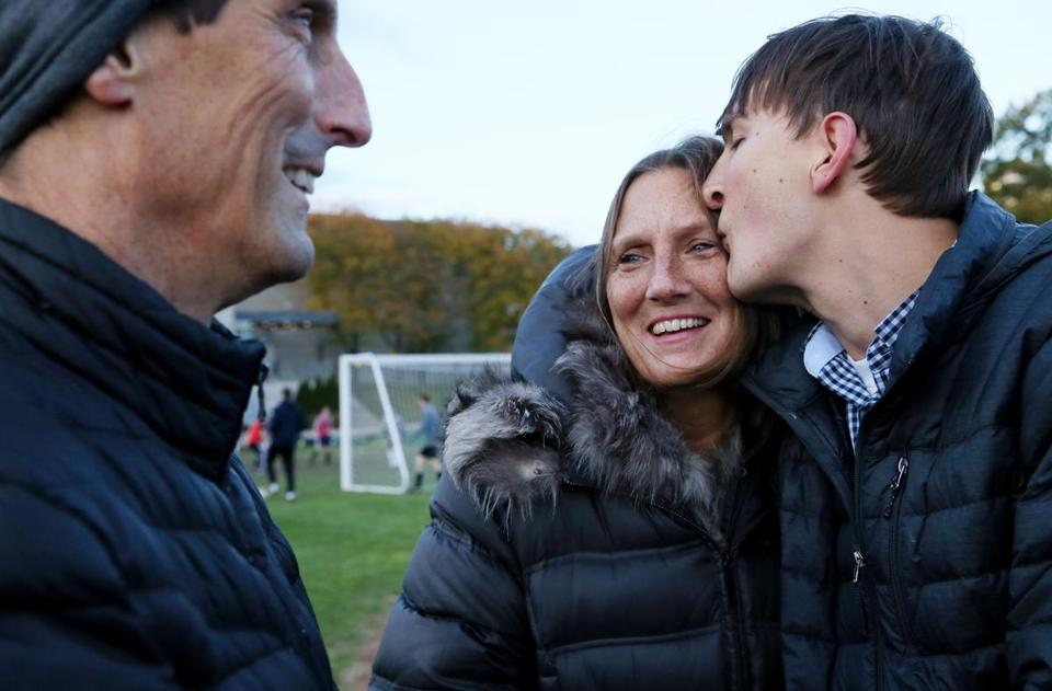 Former BB&N football player Zach McLeod shares a moment with his parents, Pat and Tammy, during practice at the school.