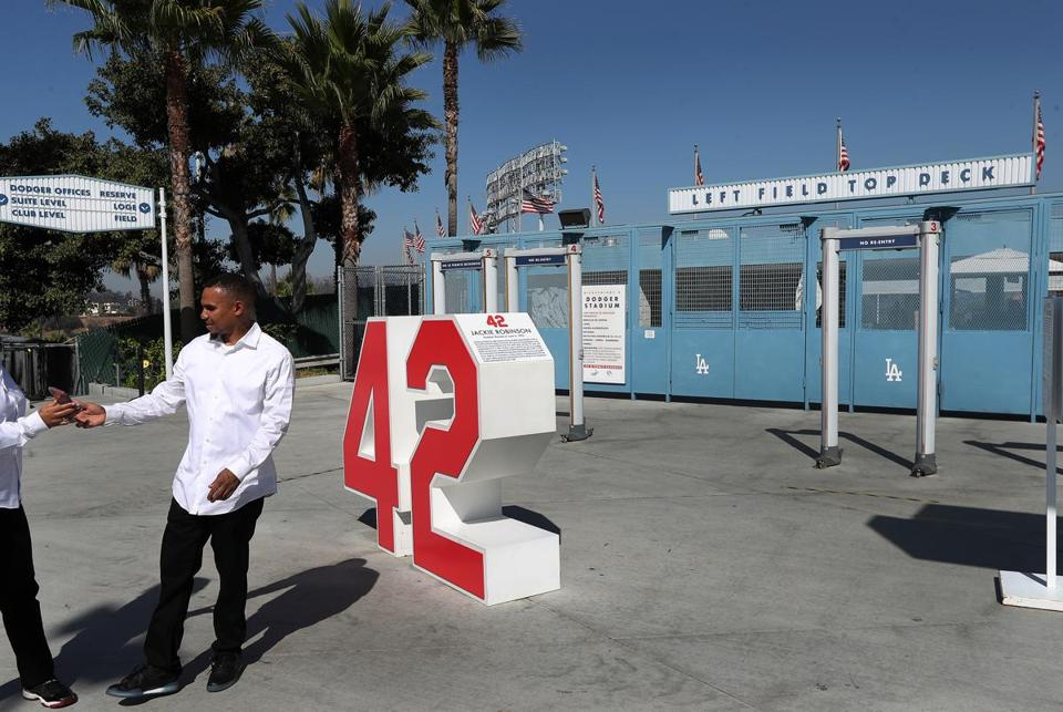 Retired number of dodgers greats are around stadium, incl. Number 42 by Jackie Robinson.