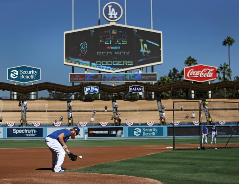 Justin Turner takes a floor ball during batting practice.