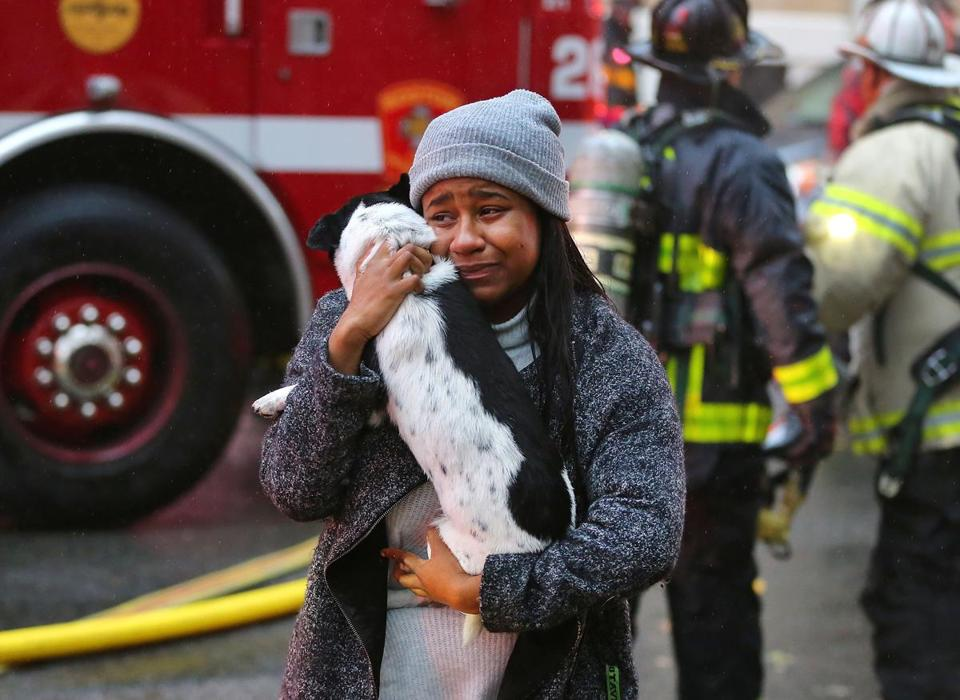 Garri Paul shouted when she handed her dog, Jax, by a fireman who saved him inside her burning apartment.