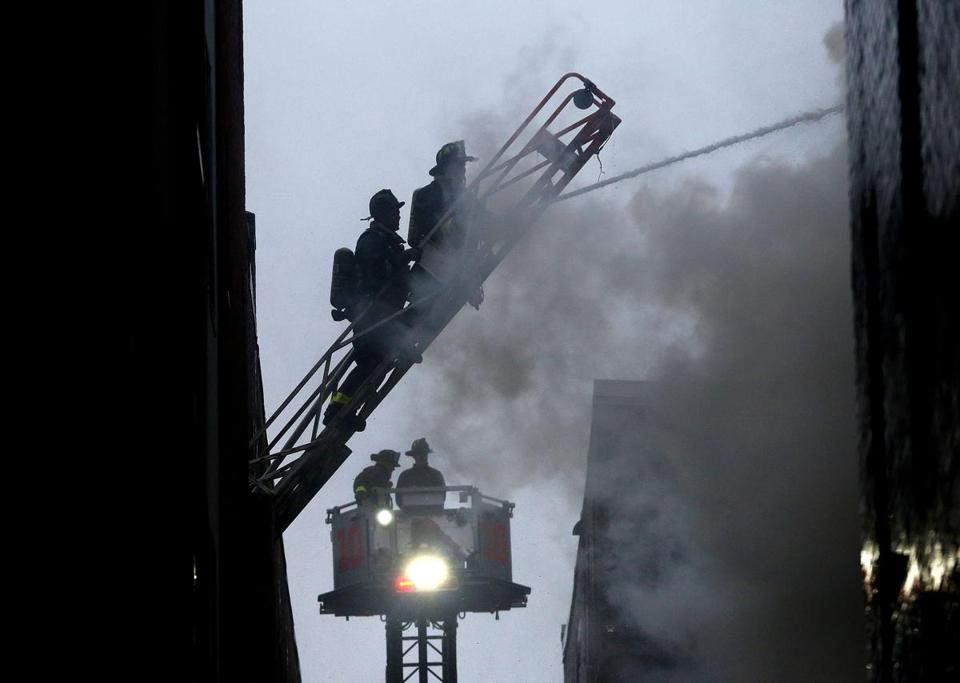 Boston firemen responded to a large apartment complex on 104 Hemenway St. during heavy wind and rain Saturday.