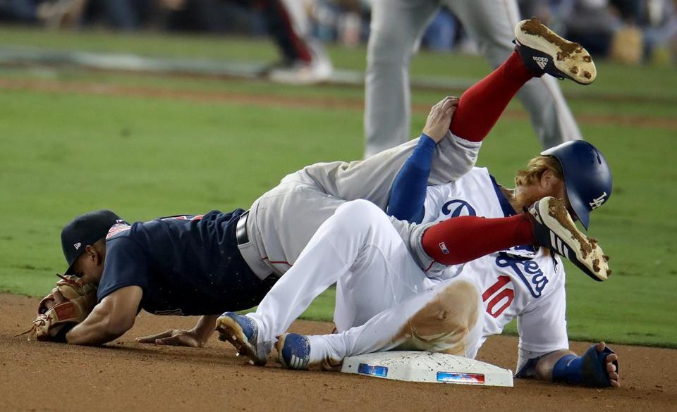 Justin Turner collided with Xander Bogaerts at the second base in the eighth inning.