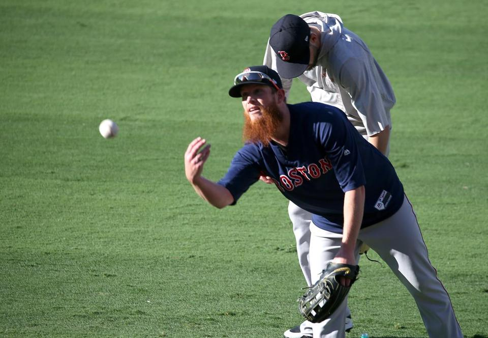 Red Sox pitcher Craig Kimbrel tosses the ball before the game.