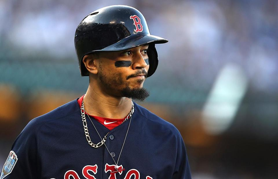 RED SOX SLIDER26 Los Angeles, CA - 10/26/2018 - Mookie Betts reacts after striking out in the first inning of Game 3 of the World Series. The Los Angeles Dodgers host the Boston Red Sox in Game 3 of the World Series at Dodger Stadium. (Jim Davis/Globe staff)