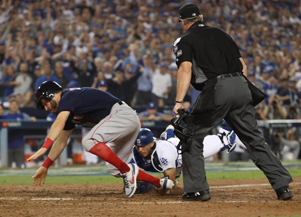 Ian Kinsler was tagged on the plate by prisoner Austin Barnes on a throw from Cody Bellinger.
