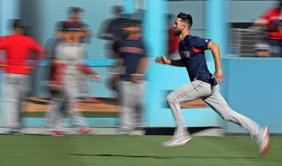 Red Sox pitcher Rick Porcello got in some running in the outfield before Game 4.