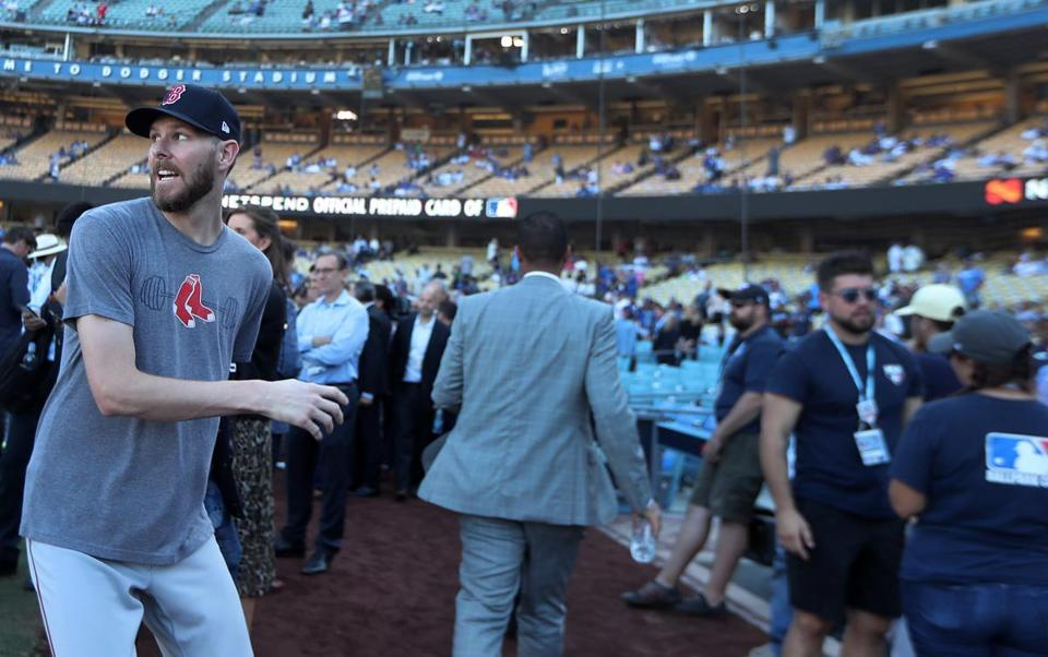 Red Sox pitcher Chris sale was hustling off the field to get to his pregame press conference when someone he knew shouted out to him, and he quickly turned around and went back to speak to him.